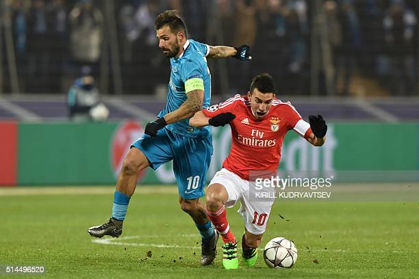 Zenit's Portuguese midfielder Danny vies for the ball with Benfica's Argentinian midfielder Nicolas Gaitan during the secondleg round of 16 UEFA...