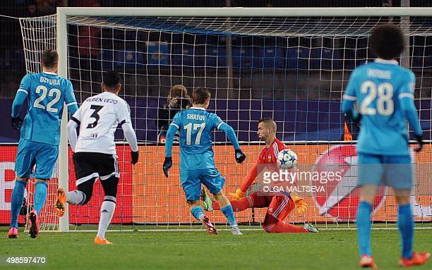 Zenit's Russian midfielder Oleg Shatov scores a goal past Valencia's goalkeeper Jaume Domenech during the UEFA Champions League group H football...
