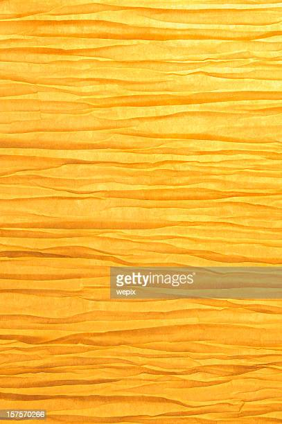 Zen-like wrinkled paper background backlit golden light