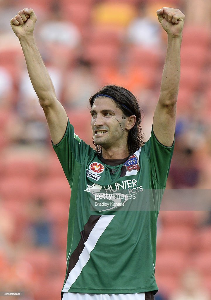 Zenon Caravella of the Jets celebrates victory after the round 19 ALeague match between Brisbane Roar and the Newcastle Jets at Suncorp Stadium on...