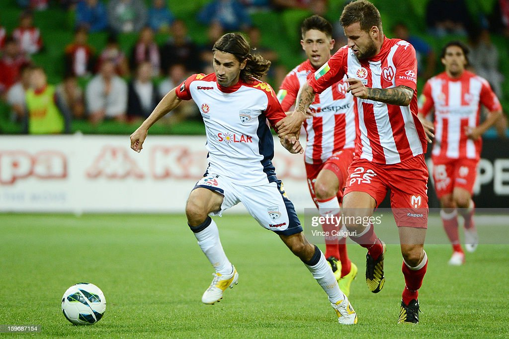 Zenon Caravella of United and Nicholas Kalmar of the Heart contest for the ball during the round seventeen A-League match between Melbourne Heart and Adelaide United at AAMI Park on January 18, 2013 in Melbourne, Australia.