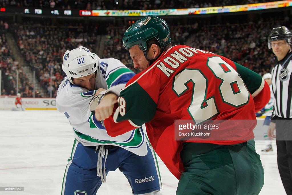 Zenon Konopka #28 of the Minnesota Wild and Dale Weise #32 of the Vancouver Canucks fight during the game on February 7, 2013 at the Xcel Energy Center in St. Paul, Minnesota.