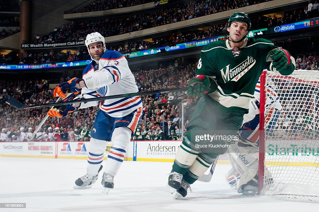 <a gi-track='captionPersonalityLinkClicked' href=/galleries/search?phrase=Zenon+Konopka&family=editorial&specificpeople=2105876 ng-click='$event.stopPropagation()'>Zenon Konopka</a> #28 of the Minnesota Wild and <a gi-track='captionPersonalityLinkClicked' href=/galleries/search?phrase=Mike+Brown+-+American+Ice+Hockey+Right+Winger&family=editorial&specificpeople=7275813 ng-click='$event.stopPropagation()'>Mike Brown</a> #13 of the Edmonton Oilers skate to the puck during the game on April 26, 2013 at the Xcel Energy Center in St. Paul, Minnesota.