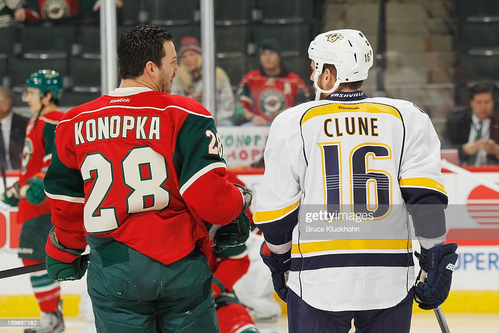 Zenon Konopka #28 of the Minnesota Wild and Rich Clune #16 of the Nashville Predators talk during warmups prior to the game on January 22, 2013 at the Xcel Energy Center in Saint Paul, Minnesota.