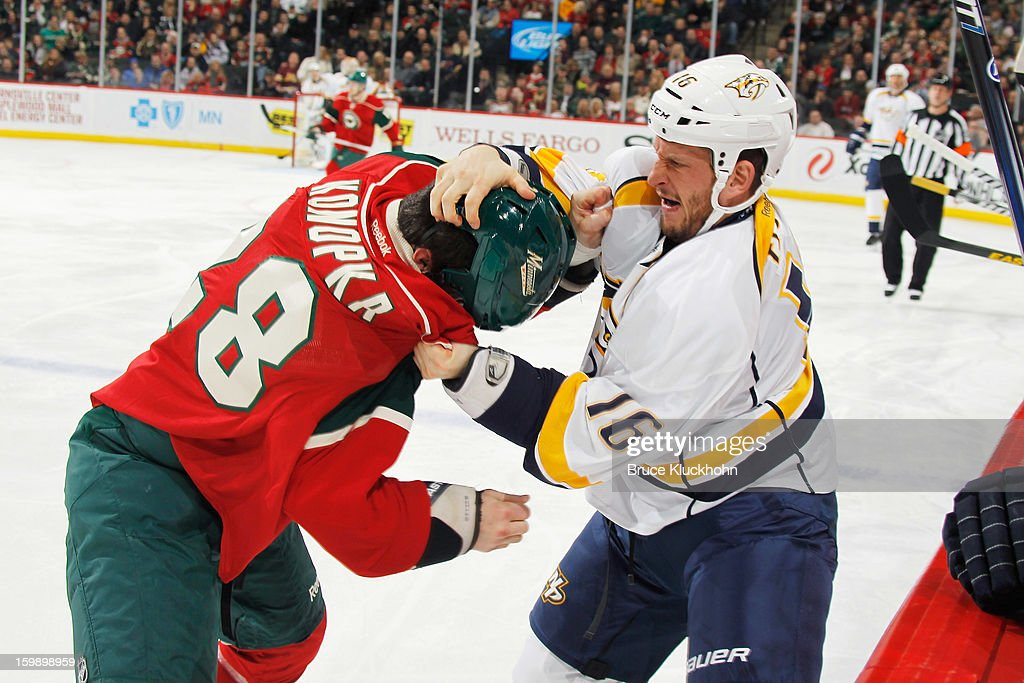 Zenon Konopka #28 of the Minnesota Wild and Rich Clune #16 of the Nashville Predators fight during the game on January 22, 2013 at the Xcel Energy Center in Saint Paul, Minnesota.