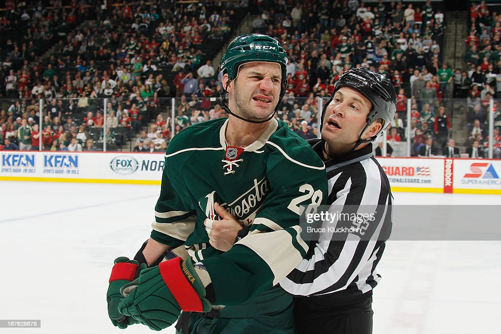 <a gi-track='captionPersonalityLinkClicked' href=/galleries/search?phrase=Zenon+Konopka&family=editorial&specificpeople=2105876 ng-click='$event.stopPropagation()'>Zenon Konopka</a> #28 of the Minnesota Wild is escorted off the ice by an official after receiving a roughing penalty and a game misconduct penalty during the game against the Edmonton Oilers on April 26, 2013 at the Xcel Energy Center in St. Paul, Minnesota.