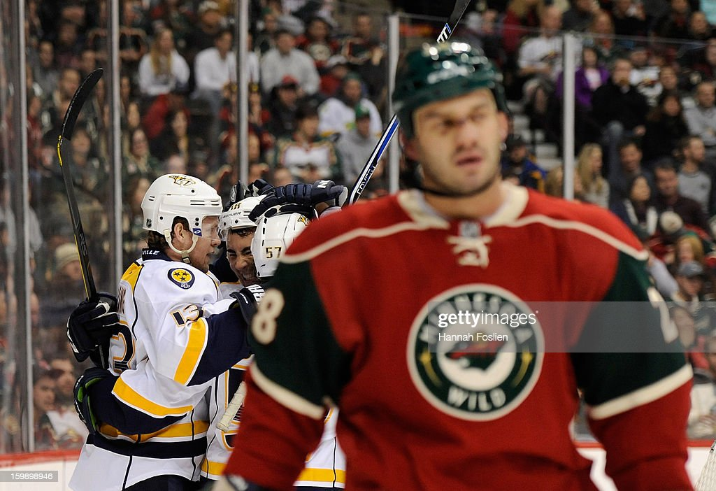 Zenon Konopka #28 of the Minnesota Wild reacts as (L-R) Nick Spaling #13, Brandon Yip #18 and Gabriel Bourque #57 of the Nashville Predators celebrate a goal by Spaling during the first period of the game on January 22, 2013 at Xcel Energy Center in St Paul, Minnesota.