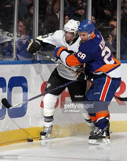 Zenon Konopka of the New York Islanders skates against Ryan Craig of the Pittsburgh Penguins on February 11 2011 at Nassau Coliseum in Uniondale New...