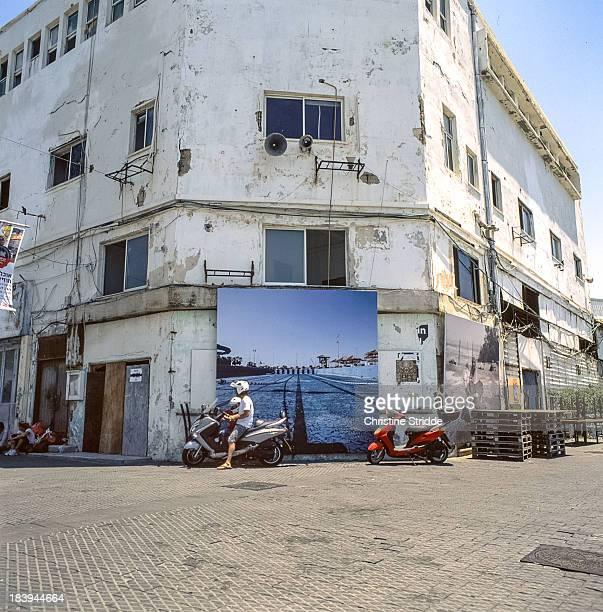 CONTENT] zenza bronica kodak ektar 100 filmphotography analogphotography old jaffa tel aviv jaffo israel street art street painting building vespa