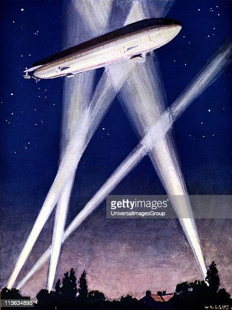 Zeppelin airship caught in searchlights during a bombing raid over England 1916 On night of 23 September London was bombed Illustration published...