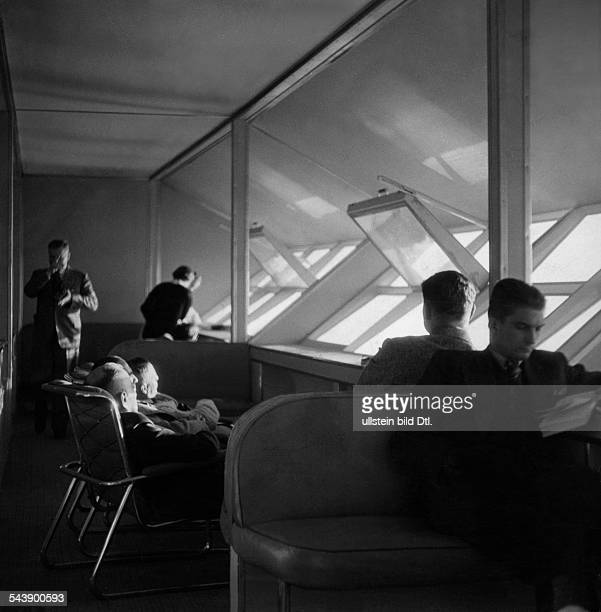 Zeppelin LZ129 'Hindenburg' travellers in a lounge with opened windows Photographer Max Ehlert Published by 'Hier Berlin' 08/1936Vintage property of...