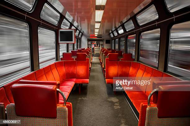 Zermatt railway inside with red seats and movement