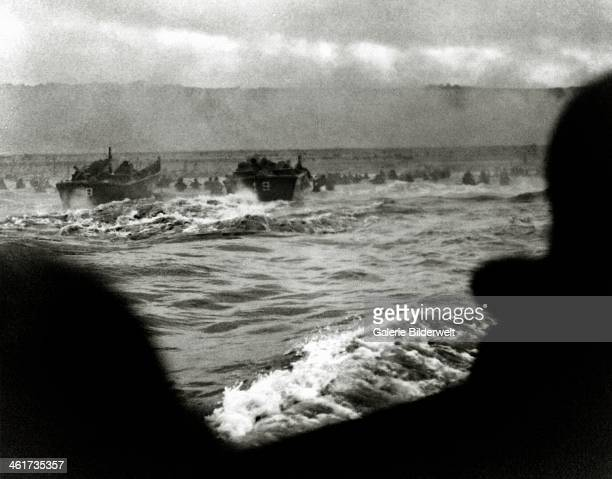 Zero Hour on Easy Red 6th June 1944 Barges run by the US Coast Guard are landing soldiers 16th Regimental Combat Team between Widerstandsnest 62 and...