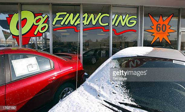 'ZeroPercent Financing For 60 Months' signage is displayed on a window at the Dodge World automobile dealership December 27 2002 in Des Plaines...