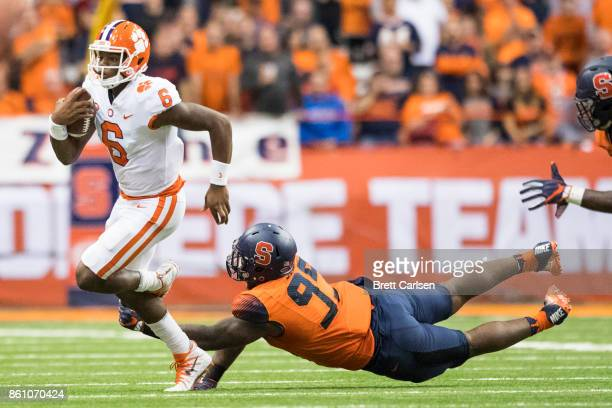 Zerrick Cooper of the Clemson Tigers is sacked by Chris Slayton of the Syracuse Orange during the fourth quarter at the Carrier Dome on October 13...