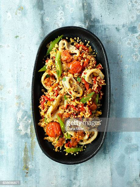 Zesty Sicilian squid, cherry tomatoes, green beans, couscous, red pepper