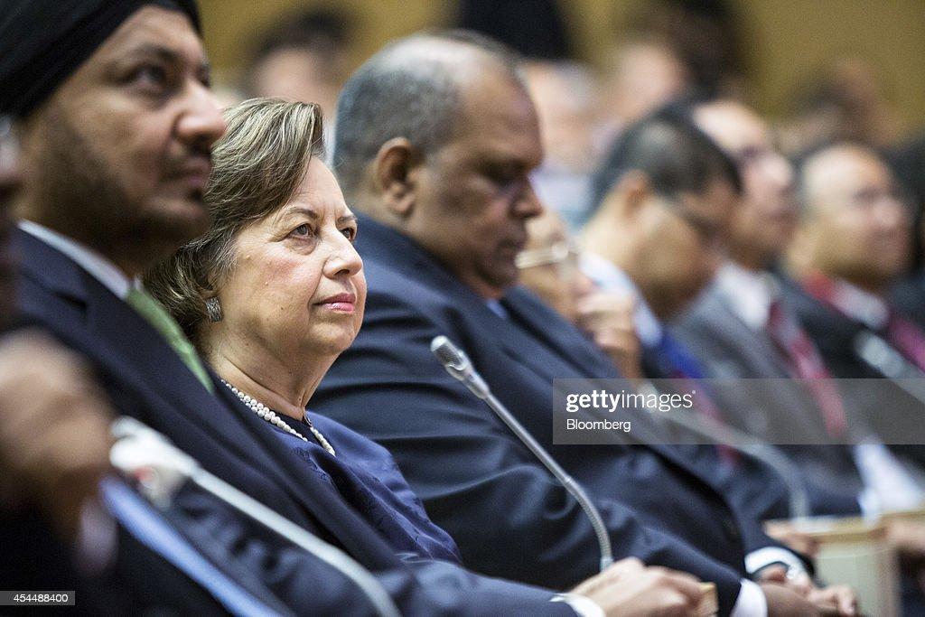 Zeti Akhtar Aziz governor of Bank Negara Malaysia second left attends the Global Islamic Finance Forum in Kuala Lumpur Malaysia on Tuesday Sept 2...