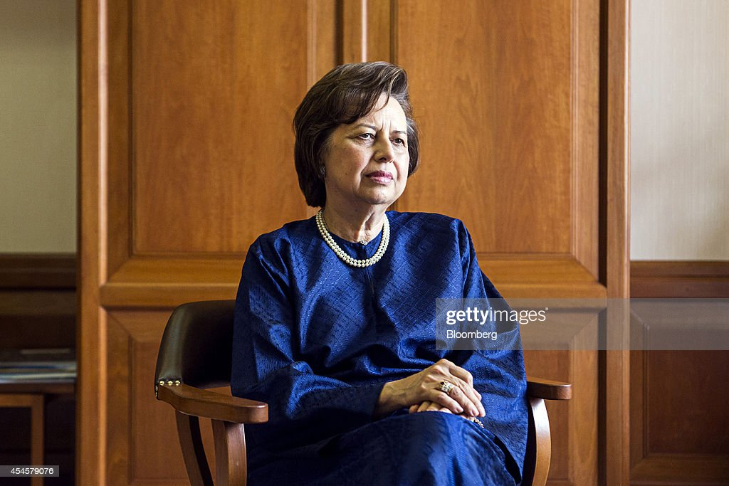 Zeti Akhtar Aziz governor of the Bank Negara Malaysia listens during an interview at the central bank headquarters in Kuala Lumpur Malaysia on...