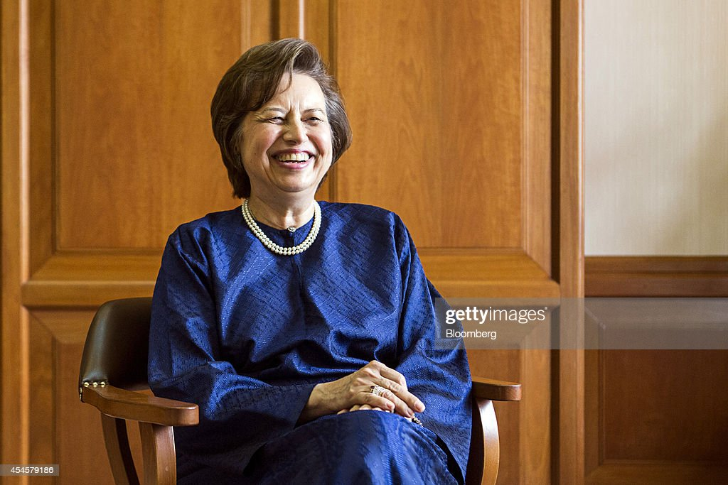 Zeti Akhtar Aziz governor of the Bank Negara Malaysia reacts during an interview at the central bank headquarters in Kuala Lumpur Malaysia on...