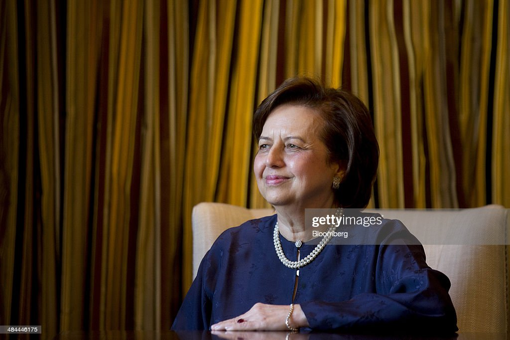 Zeti Akhtar Aziz governor of the Bank Negara Malaysia sits for a photograph following an interview on the sidelines of the International Monetary...