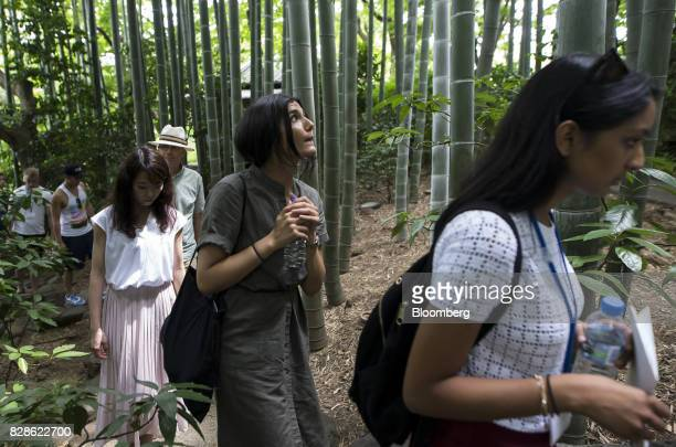 Zeynep Arican center walks through a Japanese garden during a cultural experience program part of Mitsubishi UFJ Financial Group Inc's Global Analyst...