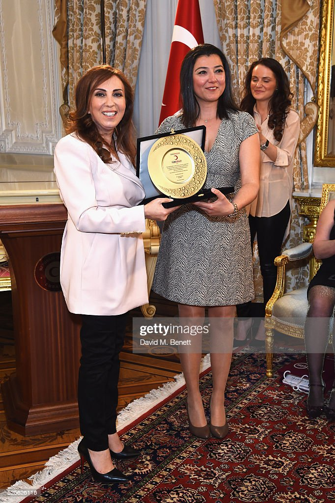 Zeynep Kartal and Ece Yilmazturk representative of Turkish Red Crescent attends the Zeynep Kartal catwalk show in support of the Syrian children refugee crisis charity Turk Kizilayi on April 28, 2016 in London, England.