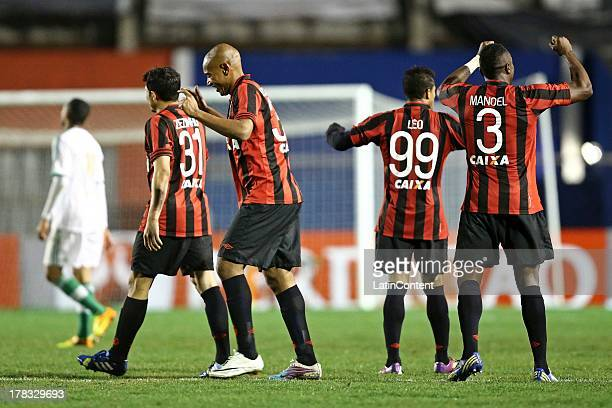 Zezinho and Paulo Baier of Atlético Paranaense celebrate a goal against Palmeiras during a match between Atlético Paranaense and Palmeiras as part of...