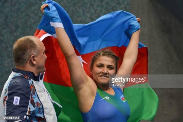Zhamila Bakbergenova of Kazakhstan celebrates after winning against Elis Manolova of Azerbaijan in the Women's Freestyle 69kg Wrestling final during...