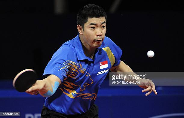 Zhan Jian of Singapore on his way to victory over Gao Ning of Singapore in the gold medal match in the men's singles Table Tennis competition at...