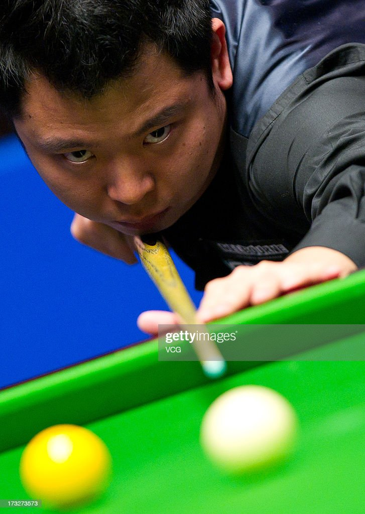 Zhang Anda of China plays a shot during the match against Mark Selby of England on day three of the World Snooker Australia Open at the Bendigo Stadium on July 11, 2013 in Bendigo, Australia.