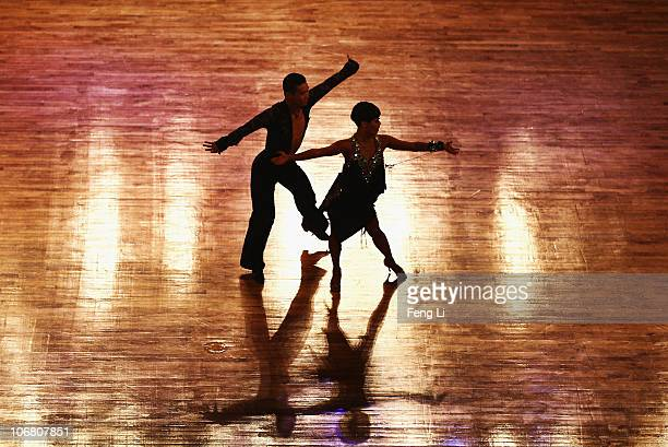 Zhang Baiyu and Shi Lei of China complete in the Latin Five Dances Competition of the Dance Sports at the Zengcheng Gymnasium during day one of the...