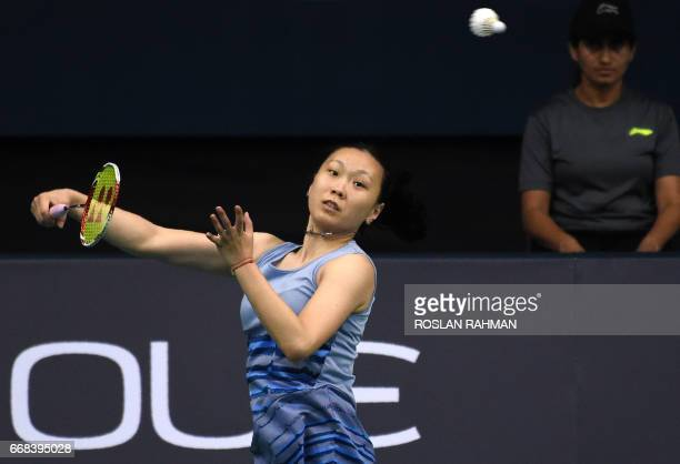 Zhang Beiwen of the US plays a shot against Akane Yamaguchi of Japan during the women's singles quarterfinal of the Singapore Open badminton...