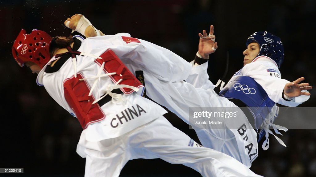 Zhang Chen of China competes against Natalia Silva of Brazil in the women's over 67 kg Taekwondo semifinal match on August 29, 2004 during the Athens 2004 Summer Olympic Games at the Sports Pavilion part of the Faliro Coastal Zone Olympic Complex.