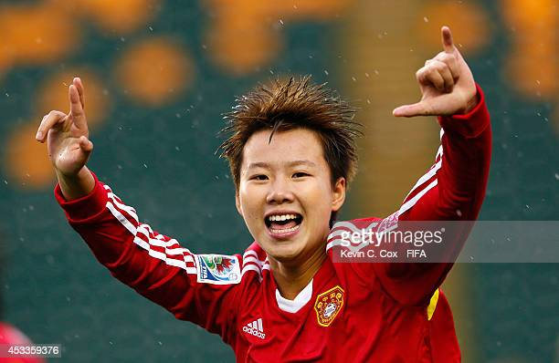 Zhang Chen of China PR celebrates scoring a goal against Germany at Commonwealth Stadium on August 8 2014 in Edmonton Canada