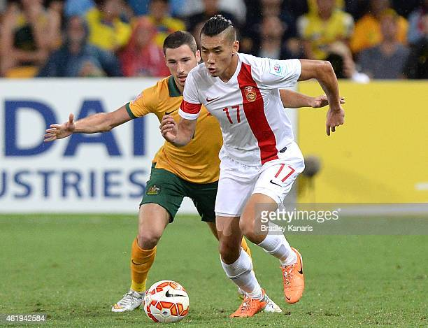 Zhang Chengdong of China and Mathew Leckie of Australia compete for the ball during the 2015 Asian Cup match between China PR and the Australian...