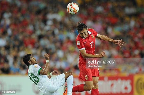 Zhang Chengdong of China PR heads the ball over Salem Aldawsari of Saudi Arabia during the 2015 Asian Cup match between Saudi Arabia and China PR at...
