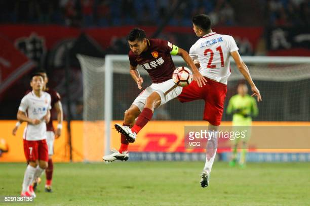 Zhang Chengdong of Hebei China Fortune and Yu Hai of Shanghai SIPG jump up to vie for the ball during the 21st round match of 2017 China Super League...
