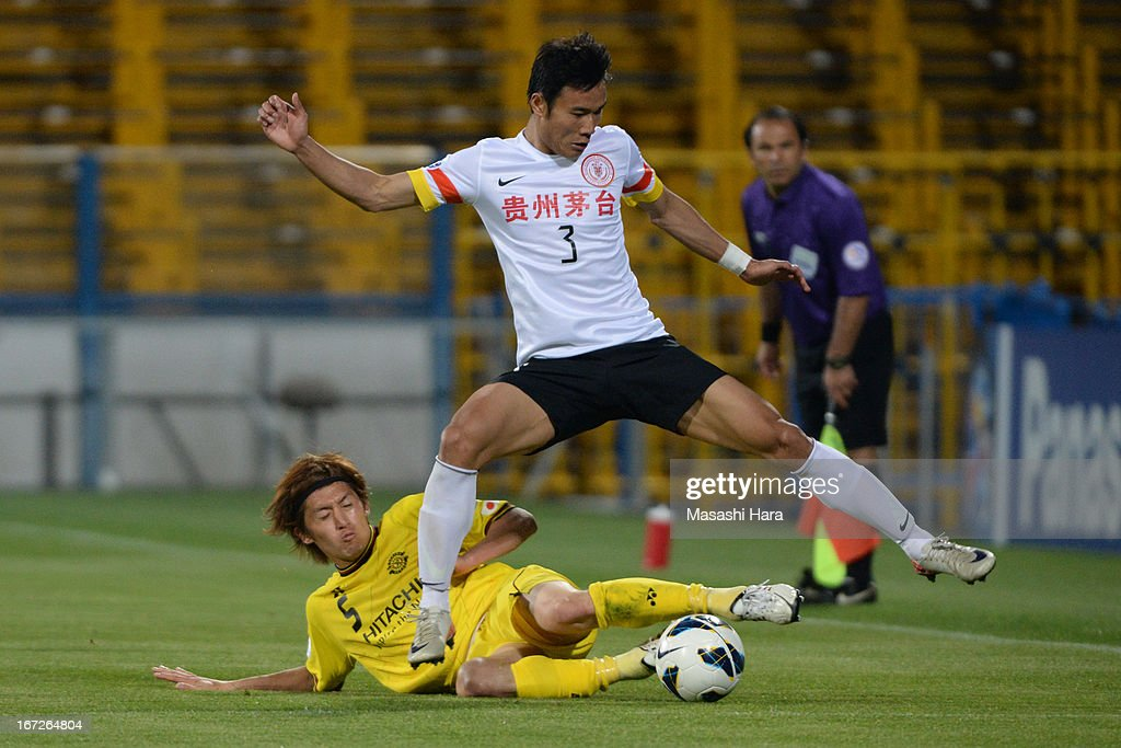 Zhang Chenglin #3 of Guizhou Renhe and Tatsuya Masushima #5 of Kashiwa Reysol compete for the ball during the AFC Champions League Group H match between Kashiwa Reysol and Guizhou Renhe at Hitachi Kashiwa Soccer Stadium on April 23, 2013 in Kashiwa, Japan.