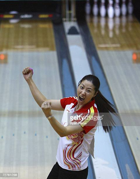 Zhang Chunli of China celebrates after scoring a strike during the Women's Team of 5 Bowling competition during day seven of the 15th Asian Games...