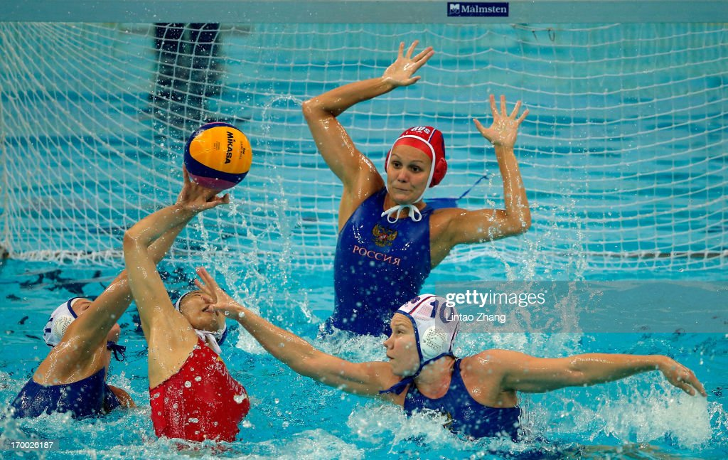 Zhang Cong of China challenges Ivanova Evgeniya and Beliaeva Olga of Russia during the Women's Water Polo Gold Medal match between the China and...