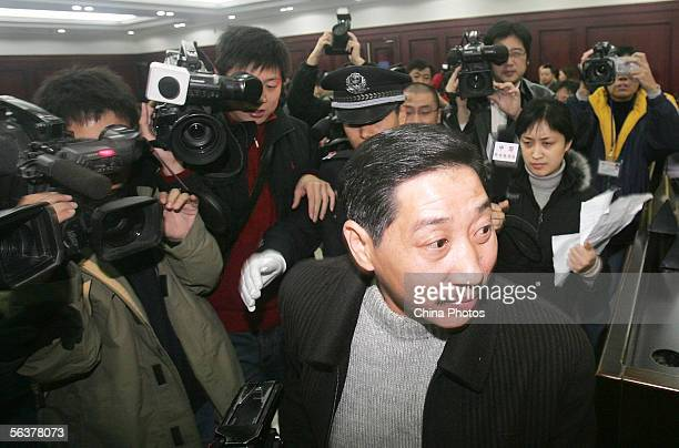 Zhang Dejun listens to a question as he is surrounded by journalists and photographers at Chenghua District Court on December 7 2005 in Chengdu of...