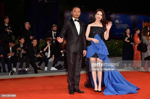 Zhang Hanyu and Qi Wei walk the red carpet ahead of the 'Manhunt ' screening during the 74th Venice Film Festival at Sala Darsena on September 8 2017...