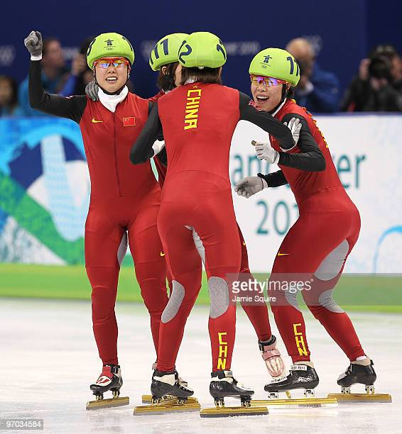 Zhang Hui Sun Linlin Wang Meng and Zhou Yang of China celebrate winning the gold medal in the Short Track Speed Skating Ladies' 3000m relay finals on...