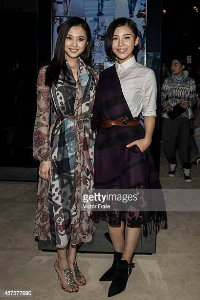 Zhang Huiwen and Yang Zishan wearing Burberry at Art of the Trench event in Chengdu on October 17 2014 in Chengdu China