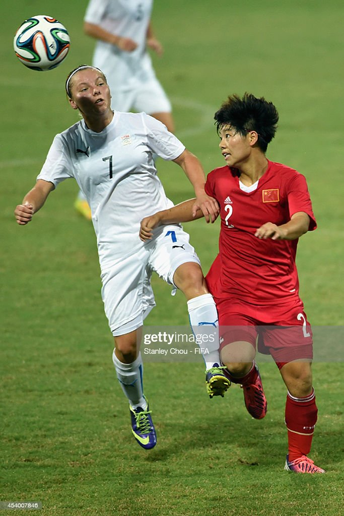 Zhang Jiayun of China battles with Alexandra Strubelova of Slovakia during the 2014 FIFA Girls Summer Youth Olympic Football Tournament Semi Final match between China and Slovkia at Wutaishan Stadium on August 23, 2014 in Nanjing, China.