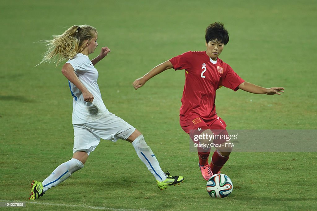 Zhang Jiayun of China battles with Tamara of Slovakia during the 2014 FIFA Girls Summer Youth Olympic Football Tournament Semi Final match between China and Slovkia at Wutaishan Stadium on August 23, 2014 in Nanjing, China.