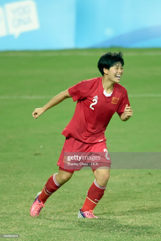 Zhang Jiayun of China celebrates after she scored from the penalty spot in the penalty shoot out after the full time scorelss draw during the 2014 FIFA Girls Summer Youth Olympic Football Tournament Semi Final match between China and Slovakia at Wutaishan Stadium on August 23, 2014 in Nanjing, China.