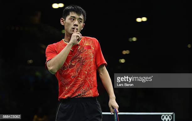 Zhang Jik of China gestures to the fans after winning his Mens Table Tennis Singles Semifinal match against Vladimir Samsonov of Belarus at Rio...