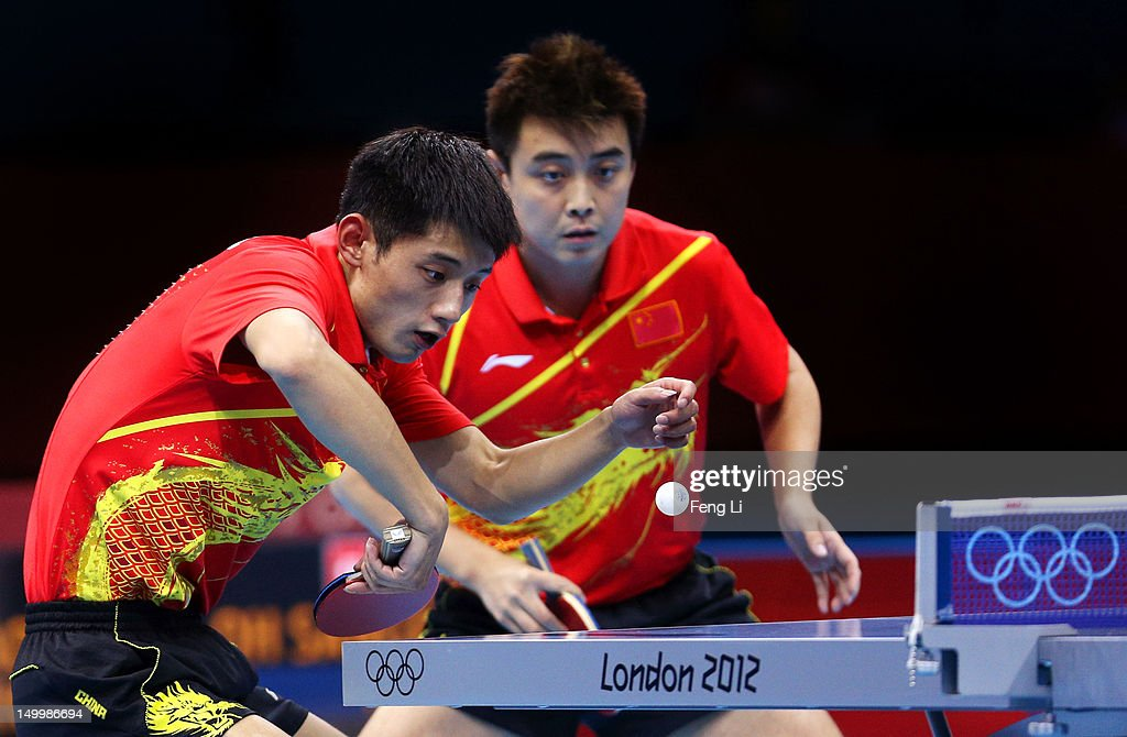 Zhang Jike (L) and Wang Hao (R) of China compete against Seungmin Ryu and Sang Eun Oh of Korea during the Men's Team Table Tennis gold medal match on Day 12 of the London 2012 Olympic Games at ExCeL on August 8, 2012 in London, England.