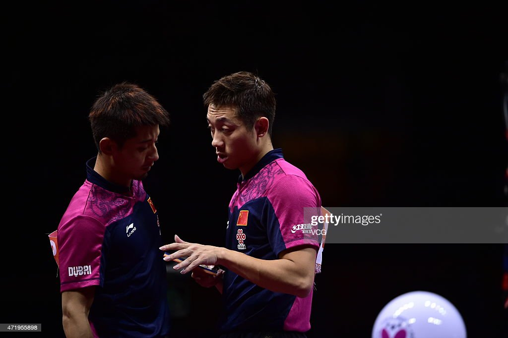 <a gi-track='captionPersonalityLinkClicked' href=/galleries/search?phrase=Zhang+Jike+-+Table+Tennis+Player&family=editorial&specificpeople=4979400 ng-click='$event.stopPropagation()'>Zhang Jike</a> (L) and <a gi-track='captionPersonalityLinkClicked' href=/galleries/search?phrase=Xu+Xin+-+Table+Tennis+Player&family=editorial&specificpeople=15781496 ng-click='$event.stopPropagation()'>Xu Xin</a> of China reacts against Fan Zhendong and Zhou Yu of China during men's mixed doubles final match on day seven of the 2015 World Table Tennis Championships at the Suzhou International Expo Center on May 2, 2015 in Suzhou, China.